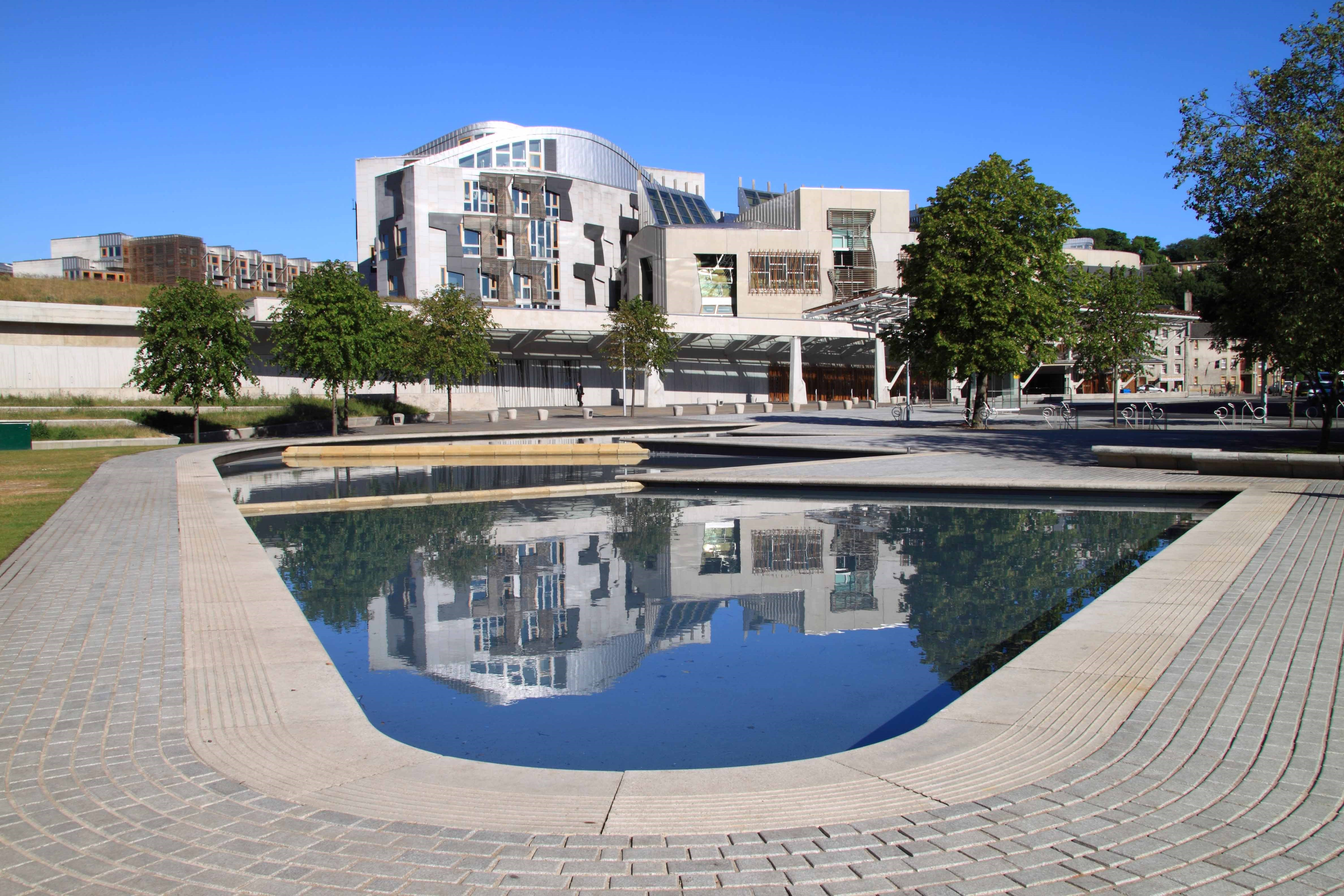 Scottish parliament viewed across a pond