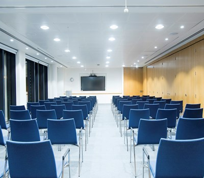 A meeting room set up theatre style from the back